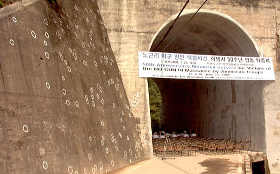At a ceremony in 2000, white circles show where bullets struck a railroad trestle at No Gun Ri, South Korea, 55 years ago. A few weeks after North Korea invaded the South in 1950, a horde of Korean refugees walked to the village of No Gun Ri, where hundreds of them reportedly were killed by the U.S. military.