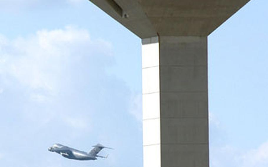 The last scheduled military flight from Rhein-Main Air Base, Germany, passes the Frankfurt International Airport control tower after take-off on Monday.