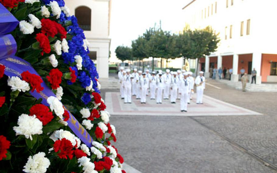 A wreathe of carnations honors America's missing in action and prisoners of war at a observance ceremony held Monday at the Capodichino Naval Support Activity base in Naples, Italy.