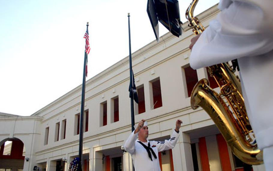 The black POW/MIA flag is flown at half-staff Monday as sailors held a remembrance ceremony.
