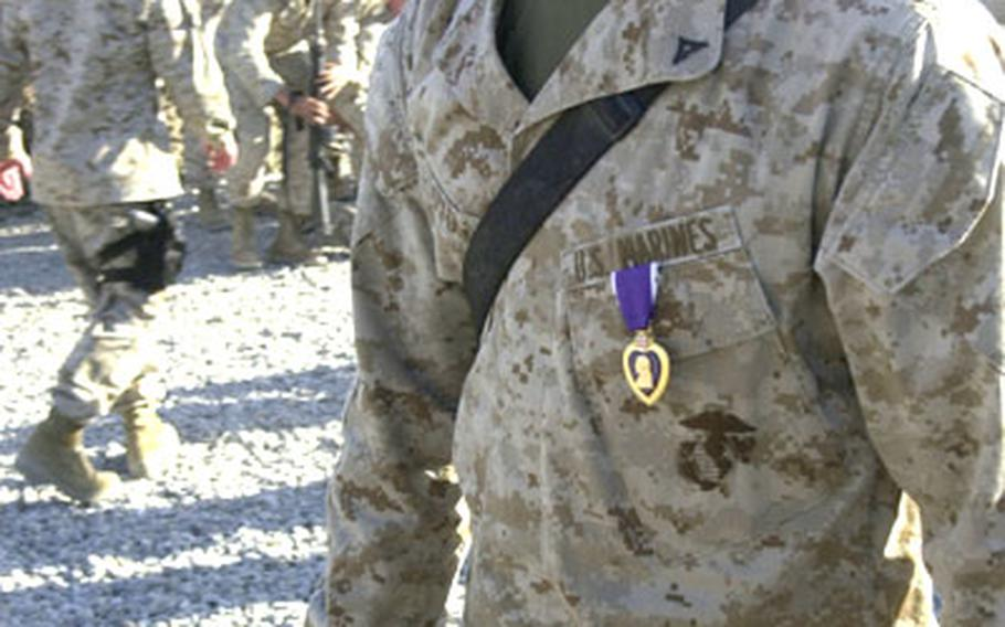 Lance Cpl. Kendall Boyd of Company F, 2nd Battalion, 3rd Marine Regiment, 3rd Marine Division, displays his Purple Heart on Monday shortly after U.S. Marine Corps Commandant Michael W. Hagee pinned the medal to his chest.
