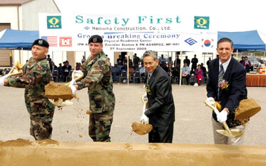 Officials take part in the groundbreaking ceremony. Work is set to start next month and finish sometime in spring 2007.