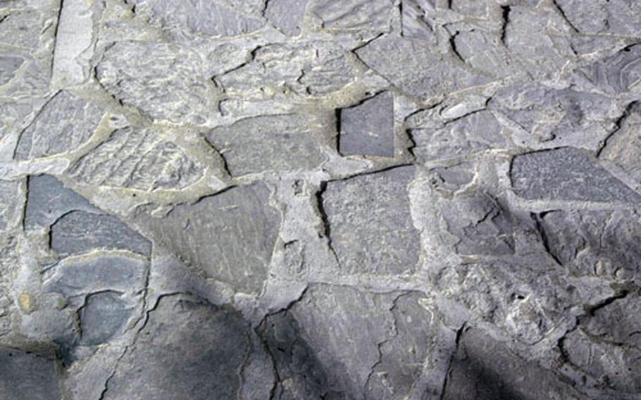 Rocks for the cobblestone road in Orgun, Afghanistan, were taken from a river bed. Local workers have spent the last few months laying the stones and mixing cement to create about 2.2 kilometers of road.