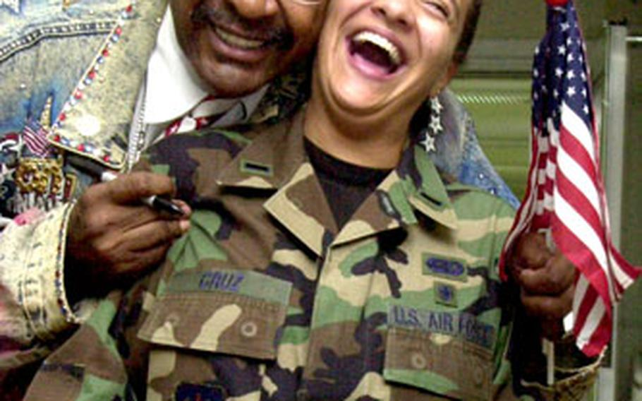 Boxing promoter Don King jokes around Monday with Lt. Courtnee Cruz at Landstuhl Regional Medical Center. King visited the Army hospital along with Ramstein Air Base this past week.