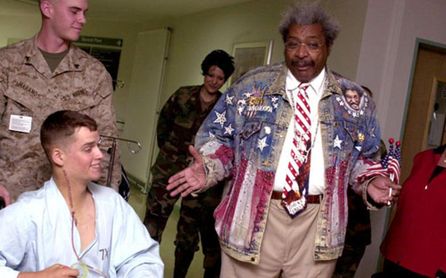 Boxing promoter Don King, right, meets with Marine Pfc John Brian at Landstuhl Regional Medical Center on Monday. King visited the Army hospital along with Ramstein Air Base this past week.