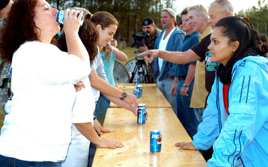 Stephanie Leeds, left foreground, guzzles a warm soda Wednesday as judge Sandra Diaz-Twine, right foreground, watches.