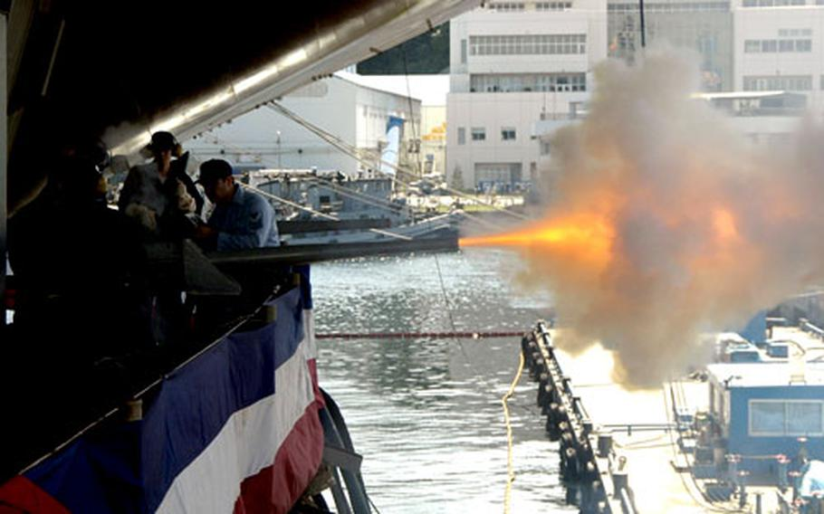 USS Kitty Hawk's weapons department sailors fire 17 rounds from two 40-milimeter saluting batteries in honor of Adm. Gary Roughead, commander, U.S. Pacific Command. Roughead was the guest speaker at the change-of-command ceremony.