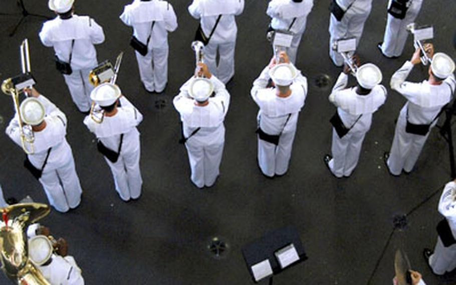 The 7th Fleet Navy Band performs during the U.S. Naval Forces Japan change-of-command ceremony conducted in the hangar bay of USS Kitty Hawk.