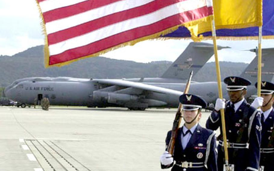 An Air Force Honor Guard stands near a C-141 Starlifter before take off at Ramstein Air Base, Germany, on Friday.