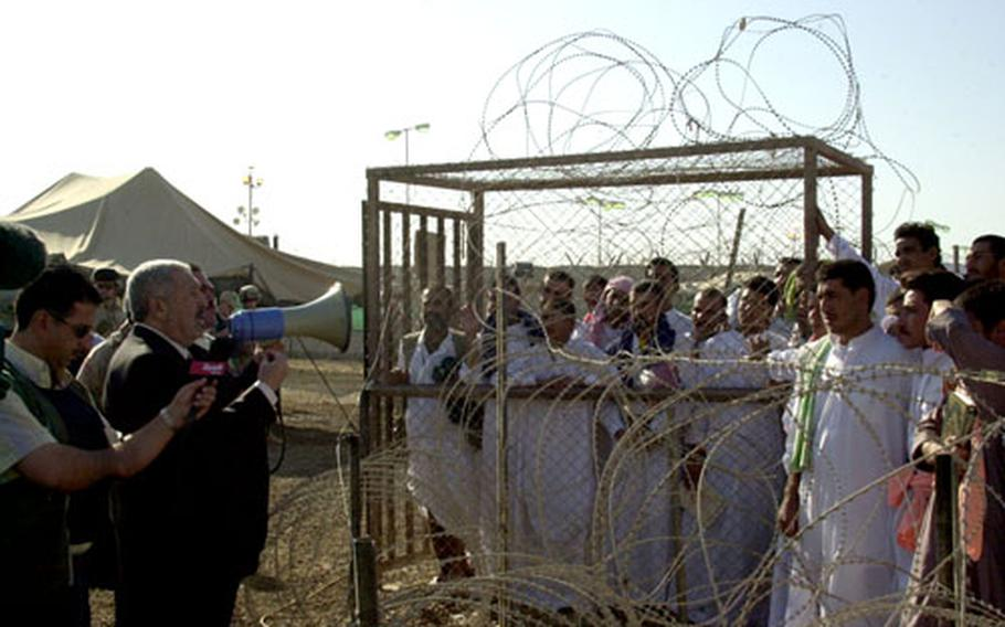 Iraqi Deputy Prime Minister Abed Motlaq Al-Jabouri urges 320 prisoners about to be released from Abu Ghraib prison Saturday to participate in the Oct. 15 constitutional referendum.