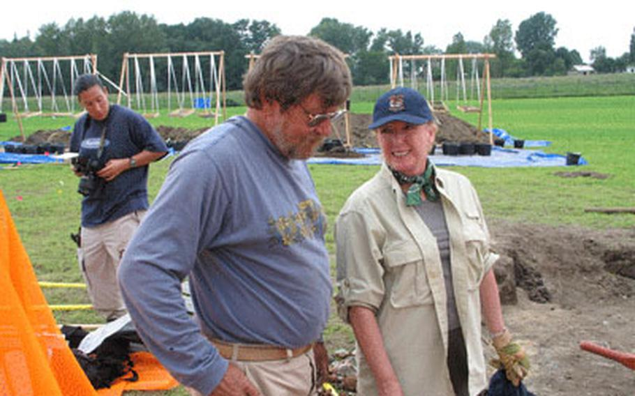 Sharon Estill Taylor on the recovery site of her father's downed P-38 near Torgau, Germany, in September. With her is Dr. Gregory Fox, a forensic anthropologist with the Joint POW/MIA Accounting Command in Hawaii.