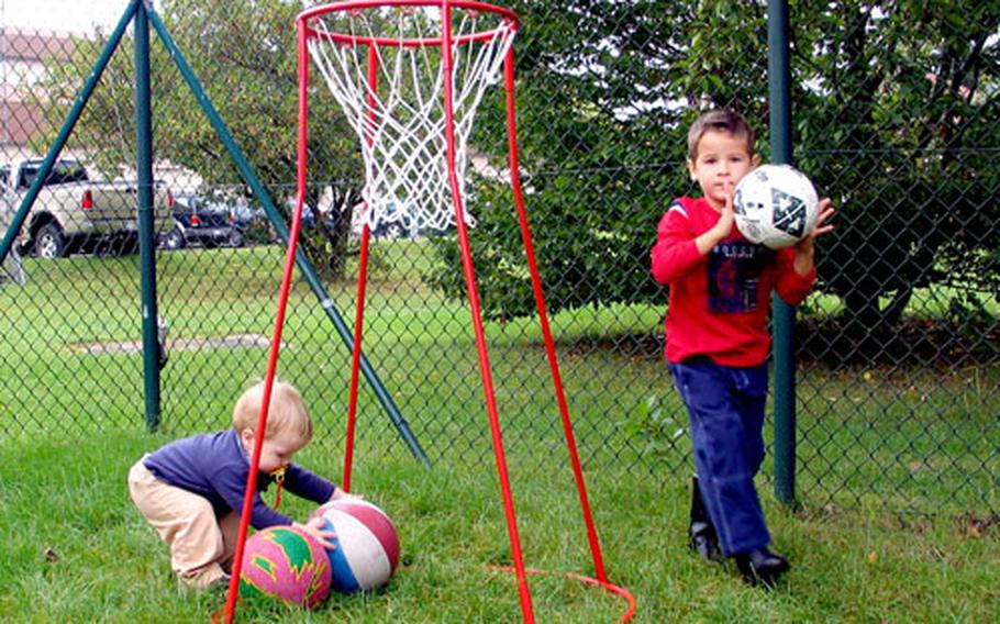Scotty MacDonald, left, and Kevin Hammer play at the hourly child-care facility playground on Warner Barracks in Bamberg, Germany, on Sept. 5. The new program lets children learn through playing.