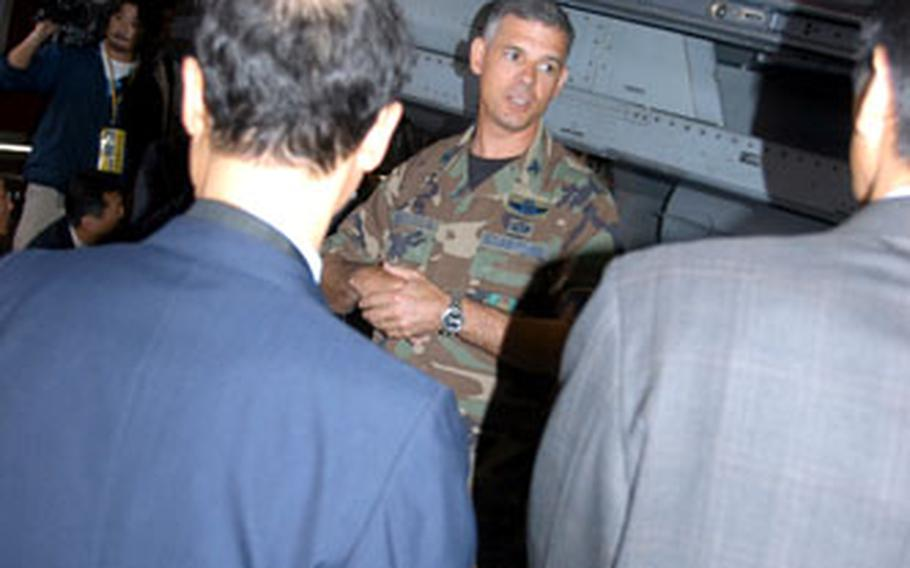Col. Sam Angelella, 35th Fighter Wing commander, speaks to Japanese government and city officials Thursday. Angelella invited the delegation to the base to explain in more detail why a pilot had to drop a concrete munition in the Pacific Ocean in September, while reasserting the wing's commitment to safety.