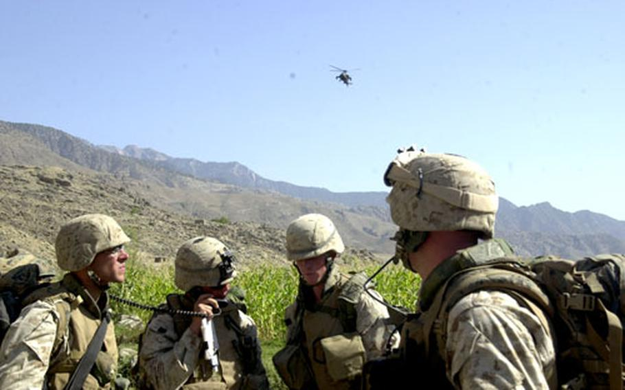 U.S. Marines with Company F, 2nd Battalion, 3rd Marine Regiment, 3rd Marine Division, out of Hawaii, speak with Apache helicopter pilots Thursday shortly after the Marines were attacked in eastern Afghanistan's Laghman province. The mortar sailed past the Marines' position, and no one was injured.
