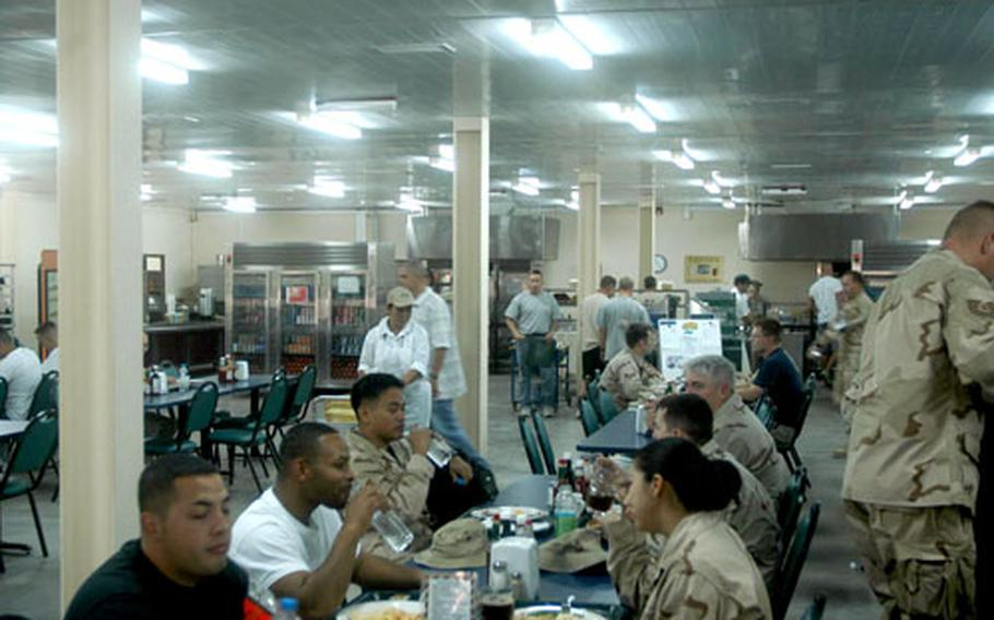 The dining facility at Manas Air Base in Kyrgyzstan opened in May, replacing a tent complex. Now, hundreds of servicemembers can eat together during one of four designated meal times or grab a more basic meal around the clock.
