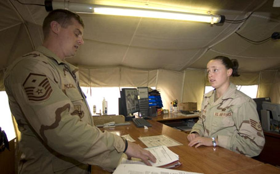 Staff Sgt. Georgette Dieckmann, also of Misawa, speaks to Master Sgt. Scott McCalla. Dieckmann and Cataldo are two of nine 35th Services Squadron personnel deployed to Manas from Misawa for the current four-month Aerospace Expeditionary Force rotation.