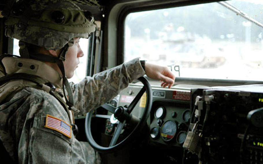 A 1st Armored Division soldier drives a Humvee during a training exercise at Hohenfels Training Area, Germany. The division is preparing for a return deployment to Iraq. The exercise included German actors playing Iraqi villagers to help soldiers interact with locals while in Iraq.