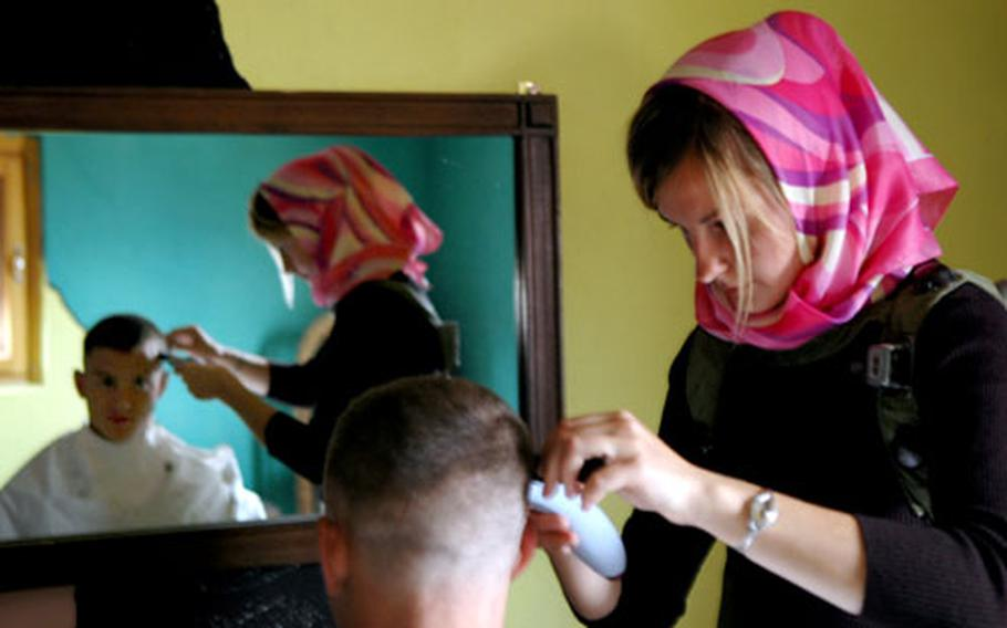 Mingling with the Iraqi population will be a crucial part of mission success in their upcoming deployment, said Capt. Chris Kuzio, who stopped for a haircut at the fake village of Rusada during a training exercise last week at Hohenfels.