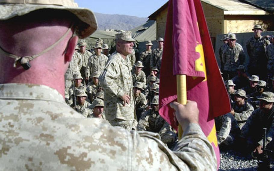 U.S. Marines Commandant Gen. Michael W. Hagee, center background, talks to Marines with Company F, 2nd Battalion, 3rd Marine Regiment, 3rd Marine Division, during a visit Monday to Forward Operating Base Mehtar Lam in eastern Afghanistan.