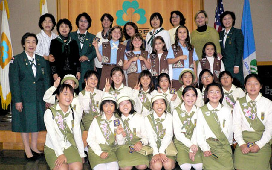 American and South Korean Girl Scouts gather Saturday in Seoul during a ceremony in which they received the Lady Baden-Powell International Friendship Award.