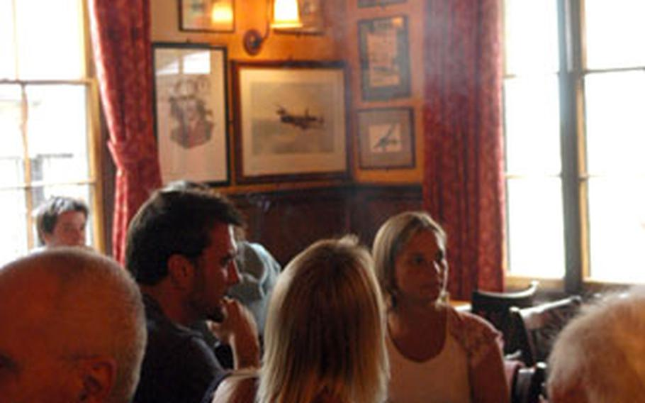 Patrons can still have a smoke in the back bar at The Eagle, where Sunday punters share a drink and a Sunday roast.