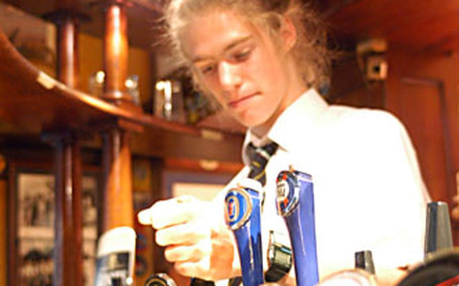 Bartender Matt Burstein pours a pint for a customer at the RAF Bar at the back of the Eagle.