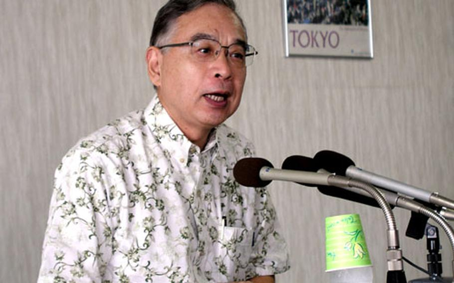 Yuji Miyamoto, ambassador in charge of Okinawan affairs for the Japanese Ministry of Foreign Affairs, talks to reporters Tuesday during a news conference in his Naha office.