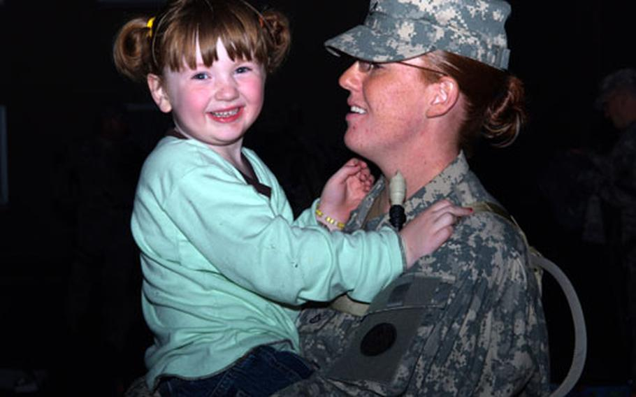 Pfc. Caryn R. Jones enjoys a laugh and smile with her daughter before deploying with 3rd Corps Support Command in support of Operation Iraqi Freedom.