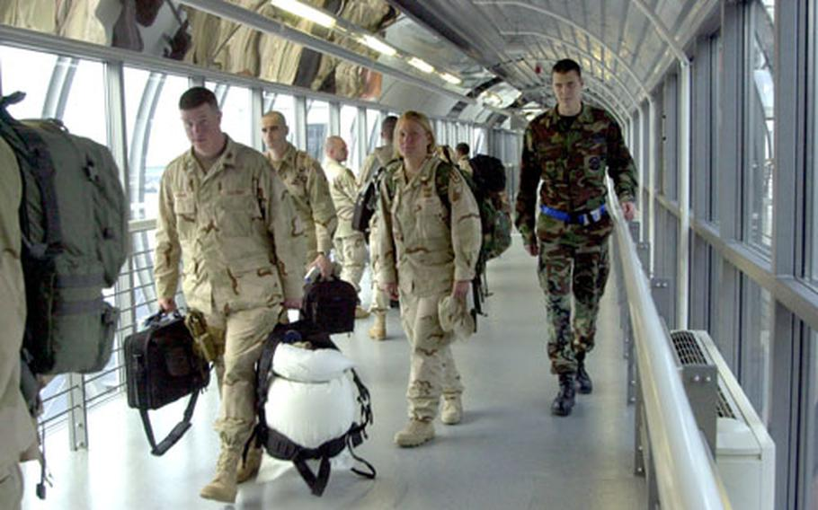 Soldiers walk down one of the corridors in the new Ramstein Air Base, Germany, passenger terminal on Thursday. The expanded terminal has seen a spike in traffic with the upcoming closure of Rhein-Main Air Base.