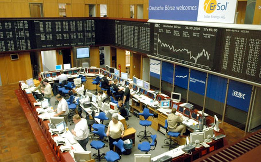 """The floor of the Frankfurt stock exchange, with its """"big board"""", the Dax, at right. The computerized Xetra Dax closes at 5:30 p.m., but trading goes continues on the floor until 8 p.m."""