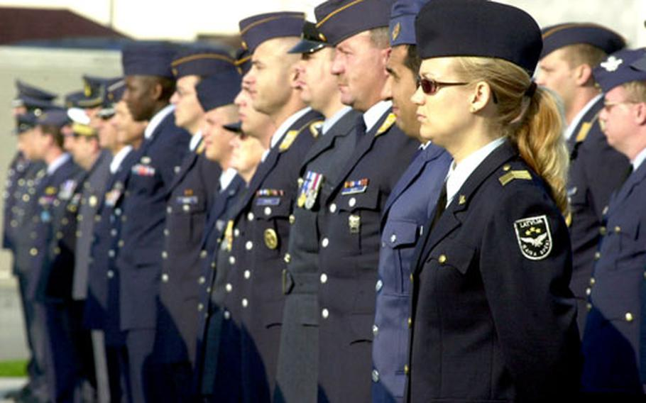 Servicemembers from various NATO countries stand during a ceremony to officially open the alliance's new Allied Air Component Command headquarters.