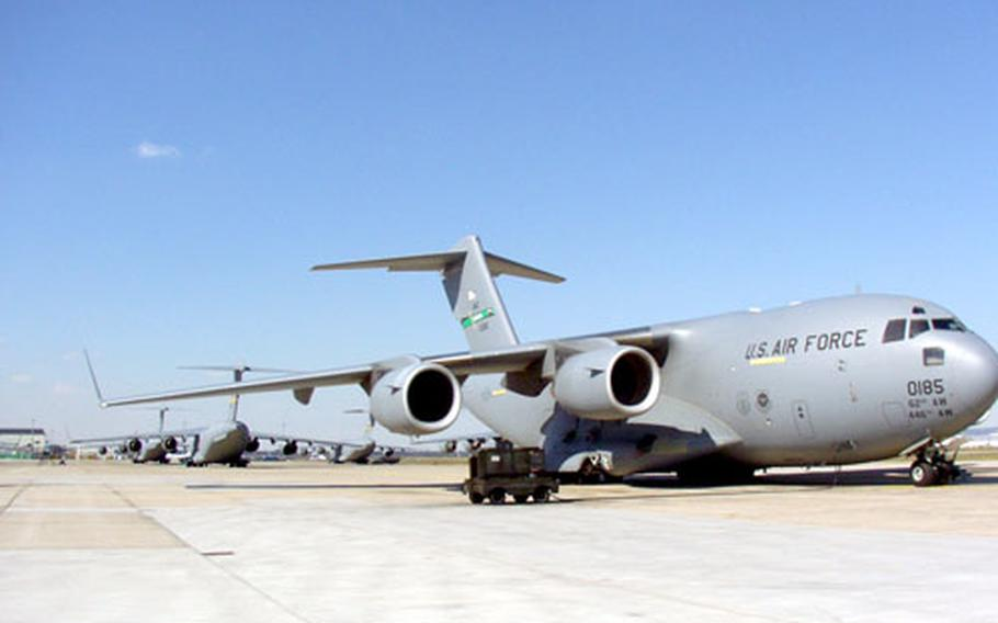 C-17 aircraft stack the flight line at Rhein-Main Air Base in April 2003, keeping squadrons busy preparing for missions in support of Operation Enduring Freedom and Operation Iraqi Freedom.