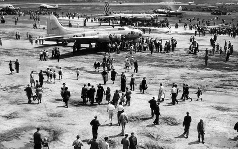 Air Force aircraft are on display at an open house on Rhein-Main Air Base on May 29, 1949. In the foreground is a B-17; behind it is a B-29. To the right of the B-29 is an F-80, and at top, from left are a C-54, a C-47 and another B-17.