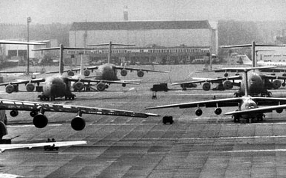 U.S. Air Force aircraft sit on the tarmac at Rhein-Main Air Base, Germany, in November 1996. They were standing by for a humanitarian airlift to Africa. From the Berlin Airlift in 1948 to its final years as an air base, Rhein-Main was involved in humanitarian missions.