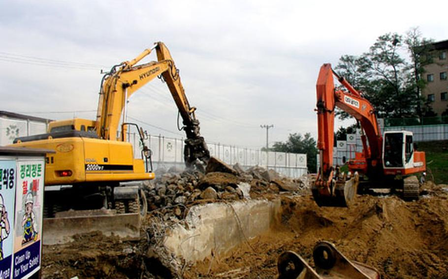 Construction gets started last week at Osan Air Base, South Korea, on a new 14-story apartment tower that will be part of a three-building family housing complex.