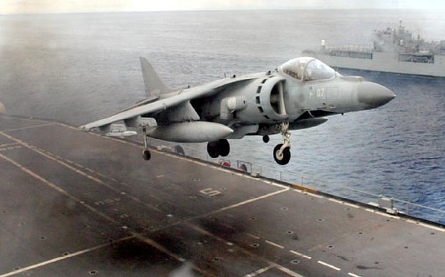 An Italian AV-8B Harrier II jet vertically takes off from the deck of the Italian aircraft carrier Giuseppe Garibaldi Friday, about 40 miles off the coast of Sardinia, Italy.