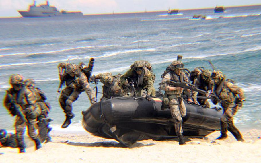 Spanish troops practice the military maneuver of storming a beach Friday at Capo San Lorenzo, Sardinia, during the multi-NATO nation exercise Destined Glory (Loyal Midas) 2005.