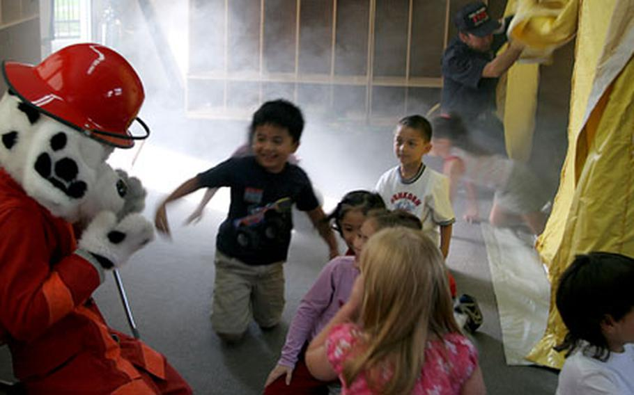 First-graders learn how to evacuate from a smoke-filled room during a simulation in a fire-safety awareness class Friday at Naval Air Facility Atsugi's Shirley Lanham Elementary School.