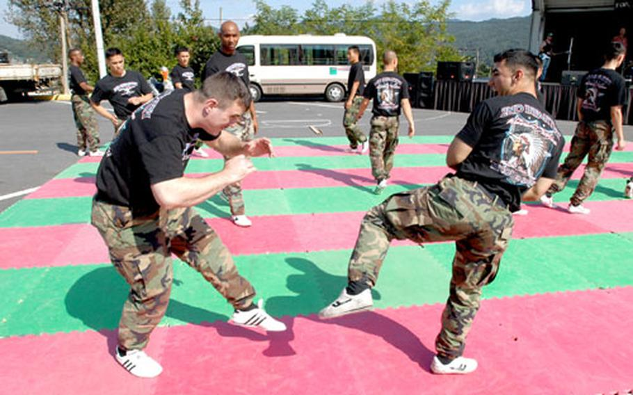 Entertainment at Camp Stanley's Oktoberfest that included a performance by the 2nd Infantry Division tae kwon do team.