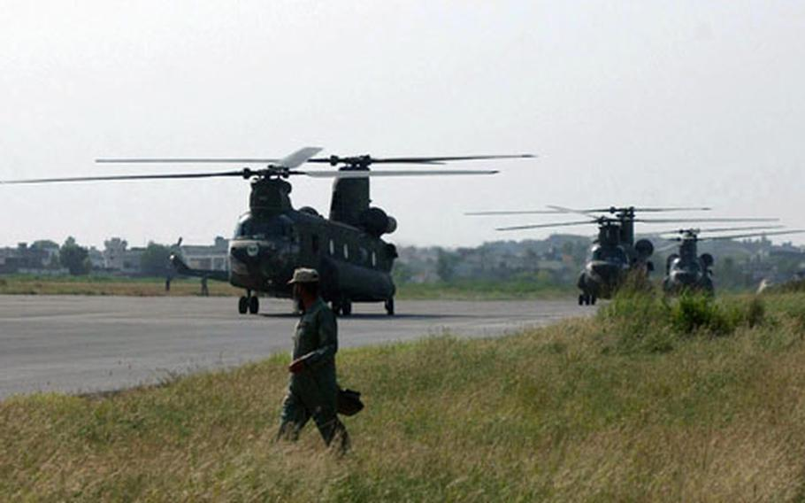 Helicopters from 3rd Battalion, 158th Aviation Regiment and 2nd Battalion, 6th Cavalry Regiment touch down on Qasim Army Airfield in Pakistan to assist in the humanitarian aid effort.