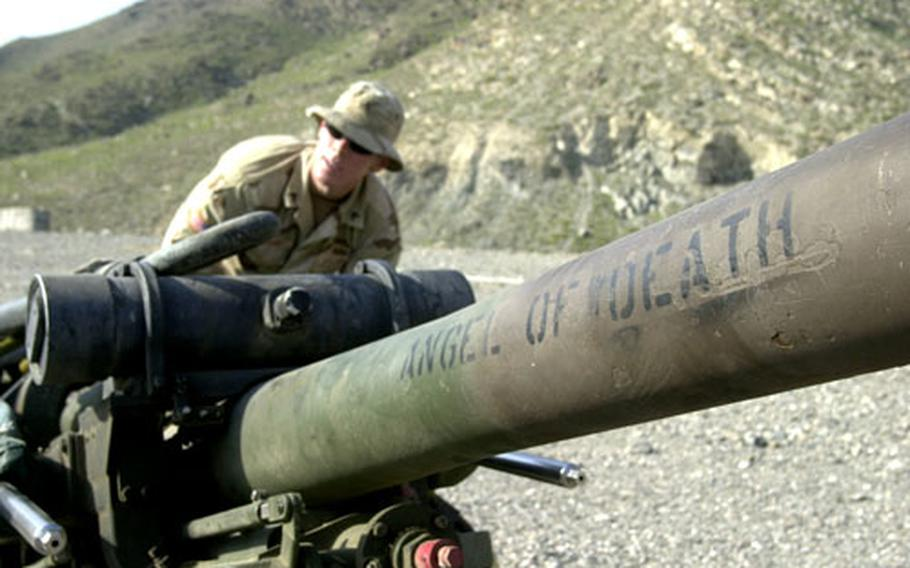 An Army sergeant prepares a howitzer to be picked up by a helicopter Tuesday from Forward Operating Base Asadabad in Afghanistan.