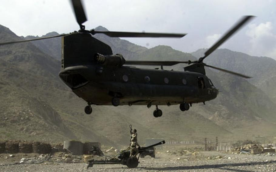 The Chinook helicopter lifts off with the 105mm howitzer.