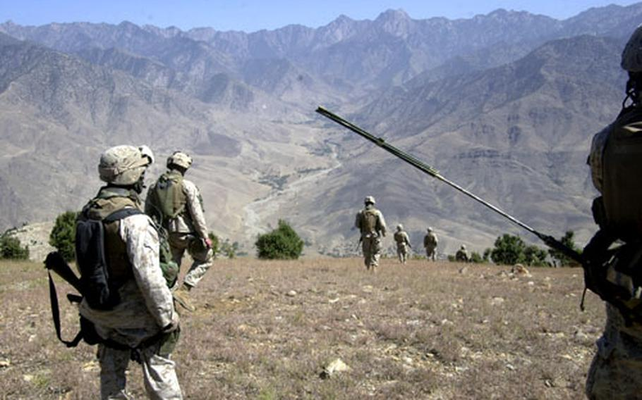 Company E Marines begin the long descent home after climbing the mountain. The Marines have become adept at operating in high altitudes and on mountainous terrain in Afghanistan.