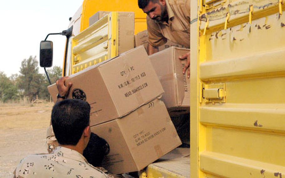 Iraqi Army soldiers unload truckloads of referendum ballots and other voting materials on the Iraqi side of FOB Normandy Thursday afternoon, in preparation for Saturday's vote.