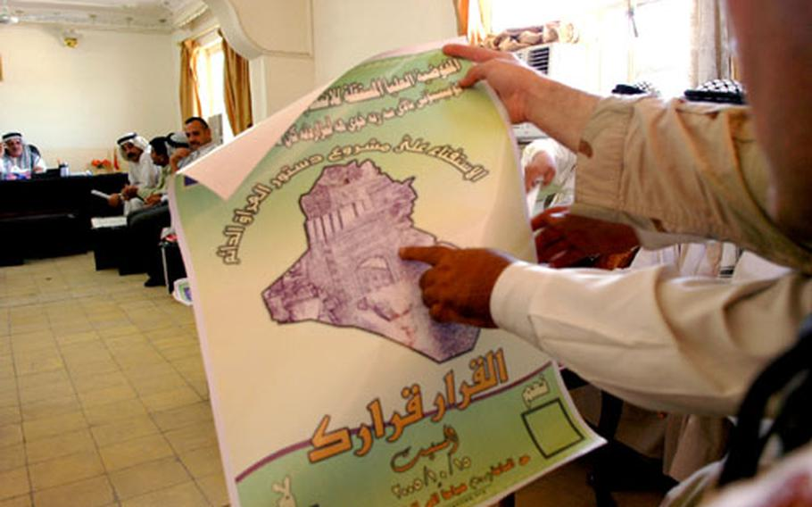 Sheiks in Tarmiyah peruse an Independent Electoral Committee of Iraq poster which encourages people to vote.