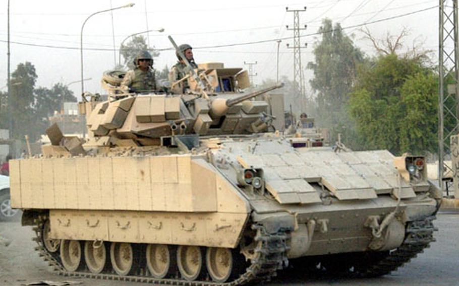 A Bradley Fighting Vehicle rolls through the streets of Samarra's Green Zone Wednesday. U.S. officials are hoping that the violence-plagued city's voters will turn out in large numbers for Saturday's constitutional referendum.