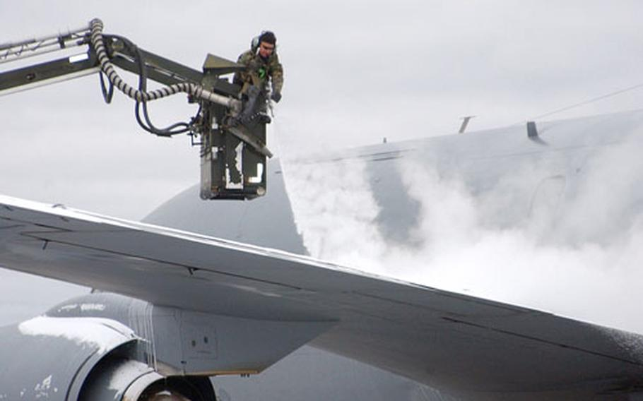An airman de-ices a KC-135 Stratotanker from Kadena Air Base, Japan, before it takes off Monday from Eielson on its first Cope Thunder mission.