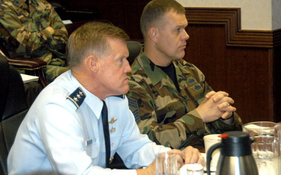 Lt. Gen. Bruce Wright, left, and Chief Master Sgt. Jim Roy listen to address by Misawa City Mayor Shigeyoshi Suzuki on Friday during the 5th Air Force Component Commanders Conference at Yokota Air Base, Japan.