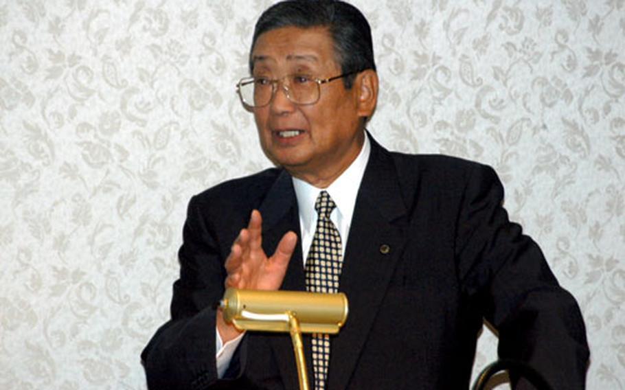 Misawa City Mayor Shigeyoshi Suzuki addresses U.S. military leaders Friday at Yokota Air Base, Japan.