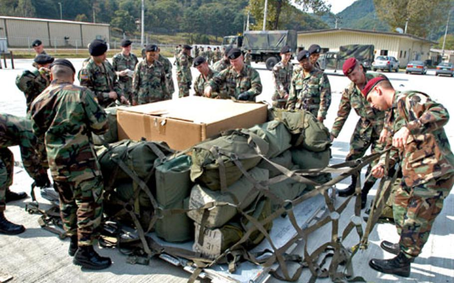 Second Infantry Division soldiers practice preparing pallets for airlift at Camp Casey, South Korea, on Thursday.